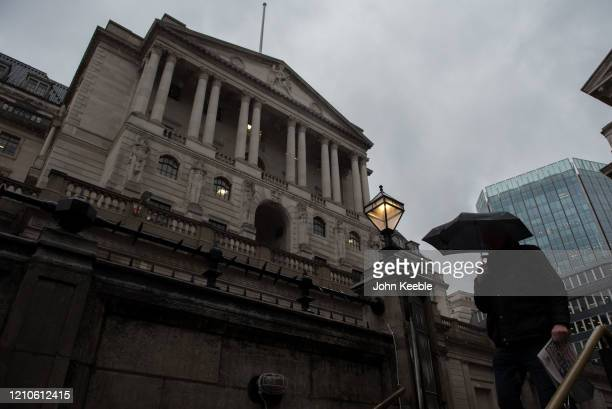 General view of people walking with umbrellas by the Bank of England on a very wet rainy day on March 5, 2020 in London, England.
