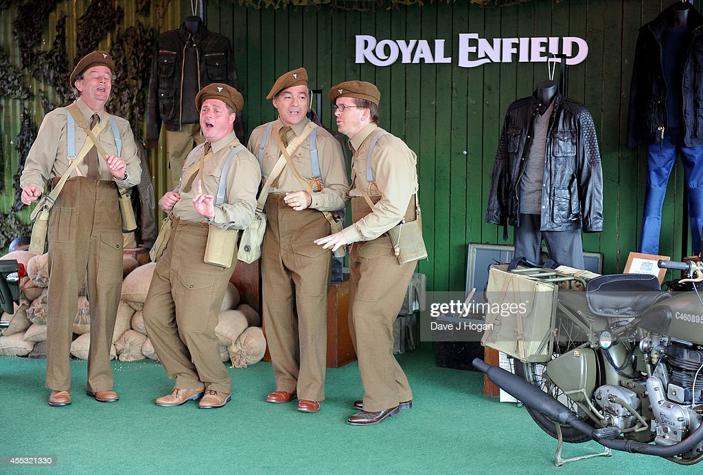 A general view of performers at the Goodwood Revival after a motorcycle ride from the Royal Enfield store in London, to celebrate the unveiling of their new accessory range inspired by World War 2 dispatch riders on September 12, 2014 in Goodwood, England.