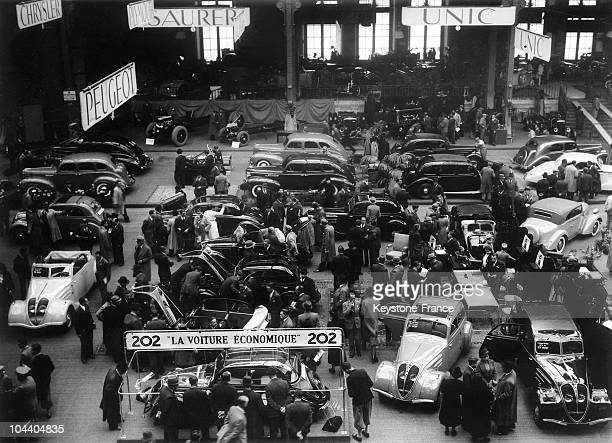 A general view of PEUGEOT stand at Paris Car Show France The firm presented its new model the 202 an 'economical' car