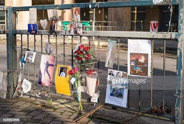 General view of photographs and messages of condolences on the traffic island as a memorial bench for the late Rik Mayall is unveiled on November 14...