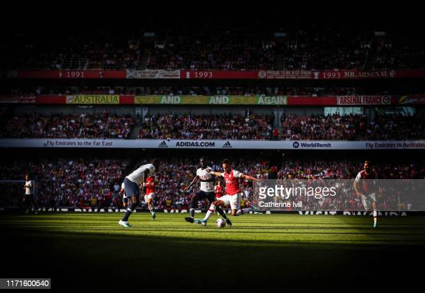 General view of PierreEmerick Aubameyang of Arsenal in action with Davinson Sanchez of Tottenham Hotspur during the Premier League match between...