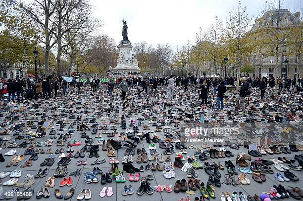 General view of Place de le Republique which is covered with shoes as part of symbolic rally organized by the NGO Avaaz during the forbidden COP21...