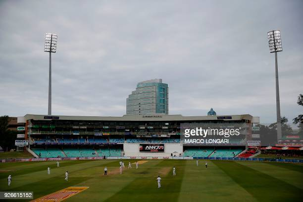 General view of play and near empty stands on day two of the first Sunfoil Test between South Africa and Australia at the Kingsmead Stadium in Durban...