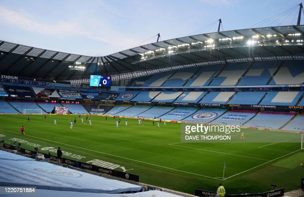 General view of play and the empty stands during the English Premier League football match between Manchester City and Arsenal at the Etihad Stadium...