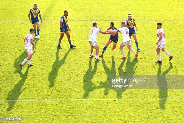 General view of play as Chris Hill of Warrington Wolves runs with the ball during the Betfred Super League match between Warrington Wolves and Hull...
