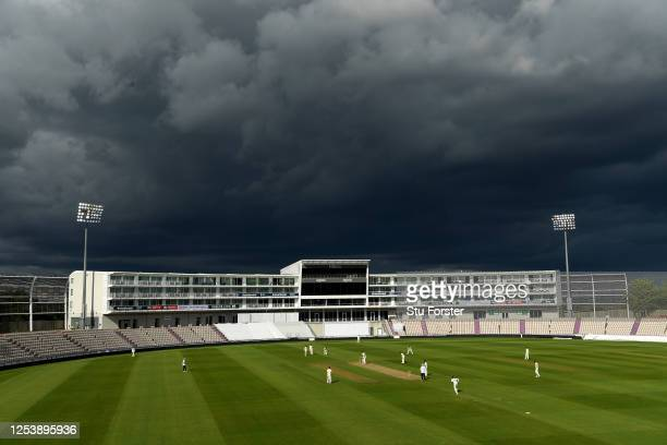 A general view of play as dark clouds loom above the ground during Day Two of the England Warm Up Match at the Ageas Bowl on July 02 2020 in...