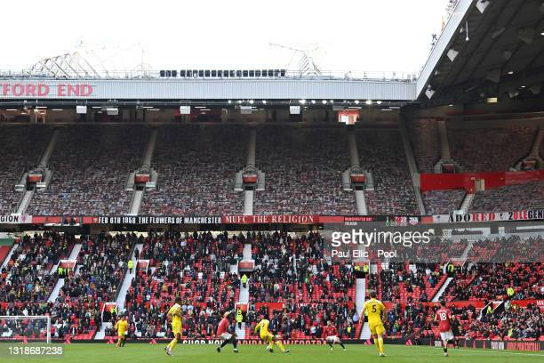General view of play as fans watch on during the Premier League match between Manchester United and Fulham at Old Trafford on May 18, 2021 in...