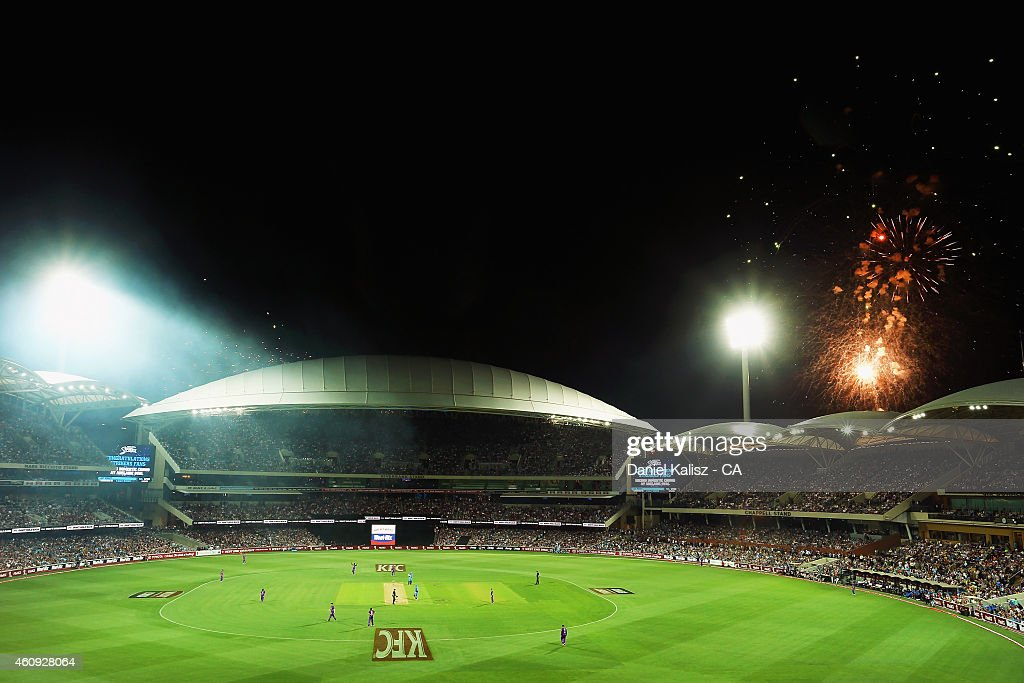 A general view of play as fireworks can be seen during celebrations for new years eve during the Big Bash League match between the Adelaide Strikers and the Hobart Hurricanes at Adelaide Oval on December 31, 2014 in Adelaide, Australia.
