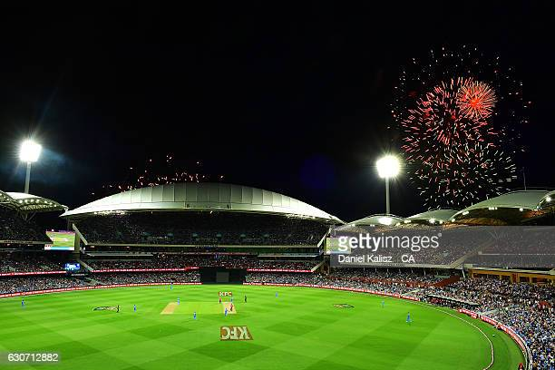 A general view of play as fireworks can be seen for new years eve celebrations during the Big Bash League match between the Adelaide Strikers and...