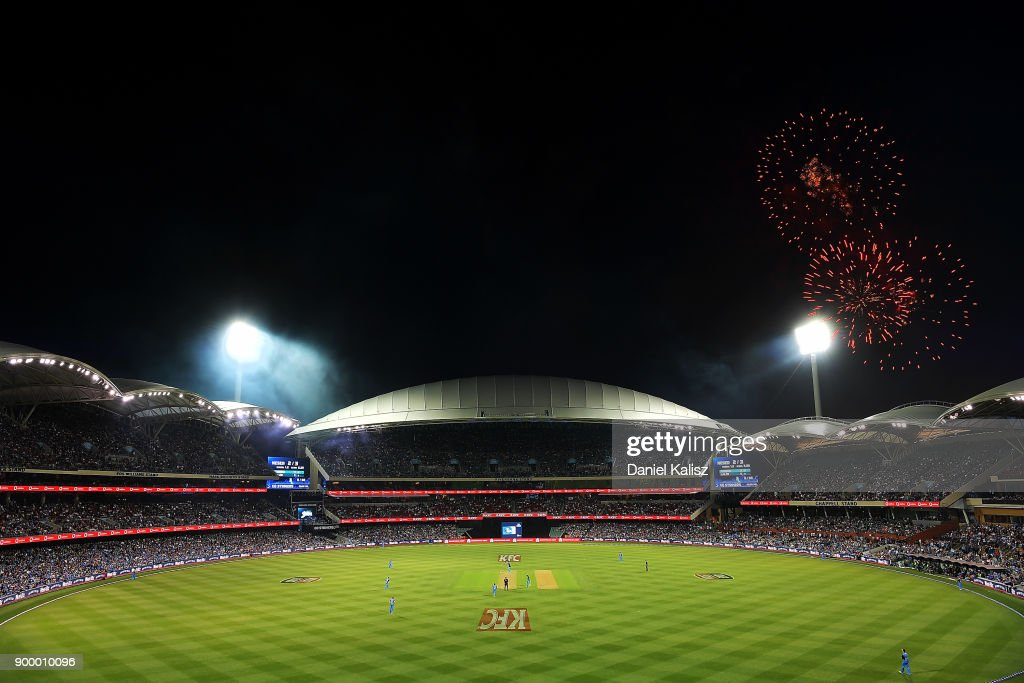 A general view of play as fireworks can be seen for new year's eve celebrations during the Big Bash League match between the Adelaide Strikers and the Brisbane Heat at Adelaide Oval on December 31, 2017 in Adelaide, Australia.