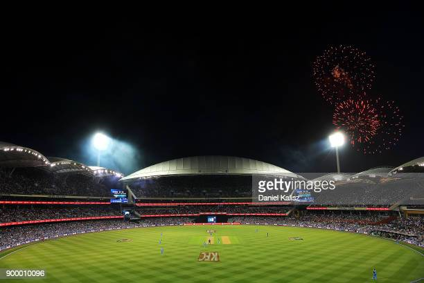 A general view of play as fireworks can be seen for new year's eve celebrations during the Big Bash League match between the Adelaide Strikers and...