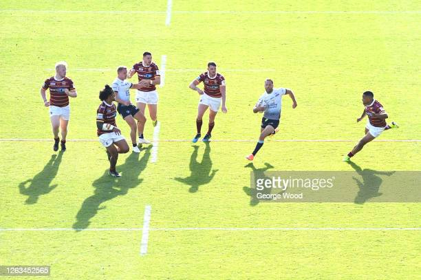 A general view of play as Luke Gale of Leeds Rhinos runs with the ball during the Betfred Super League match between Huddersfield Giants and Leeds...
