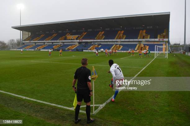 General view of play as Myles Weston of Dagenham And Redbridge takes a corner kick during the Emirates FA Cup Second Round between Mansfield Town and...