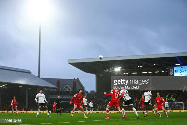A general view of play as rain falls during the Sky Bet Championship match between Fulham and Barnsley at Craven Cottage on February 15 2020 in...
