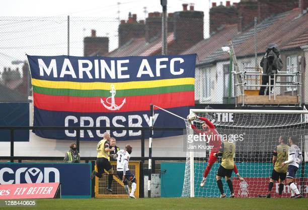 General view of play as Ross Worner of Havant and Waterlooville catches the ball during the Emirates FA Cup Second Round match between Marine FC and...