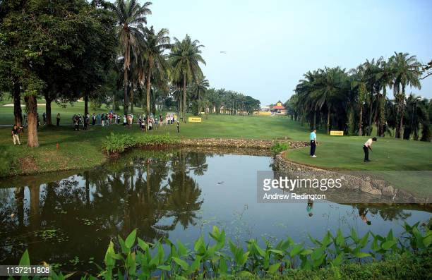 A general view of play as Shubhankar Sharma of India putts on the tenth green on Day One of the Maybank Championship at Saujana Golf Country Club...