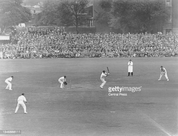 General view of play as spectators watch Arthur Richardson of Australia at bat during the Australian 1st innings of the 5th Test match of the England...