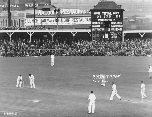 General view of play as spectators watch Clarrie Grimmett of Australia at bat during the Australian 1st innings of the 4th Test match of the England...