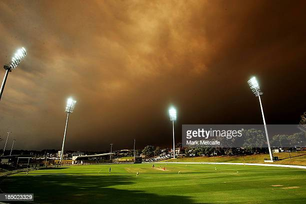 A general view of play as the skyline is shrouded in smoke during the Ryobi Cup match between the South Australian Redbacks and the Western Australia...