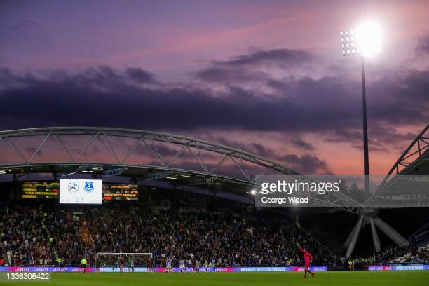 General view of play as the sun sets during the Carabao Cup Second Round match between Huddersfield Town and Everton at The John Smith's Stadium on...