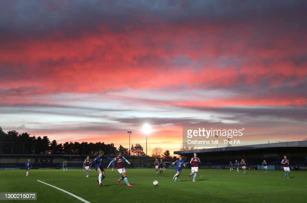 General view of play as the sun sets during the FA Women's Continental League Cup Semi Final match between Chelsea and West Ham United at Kingsmeadow...