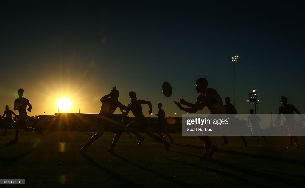 A general view of play as the sun sets during the JLT Community Series AFL match between the Melbourne Demons and the St Kilda Saints at Casey Fields on March 8, 2018 in Melbourne, Australia.