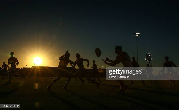 A general view of play as the sun sets during the JLT Community Series AFL match between the Melbourne Demons and the St Kilda Saints at Casey Fields...