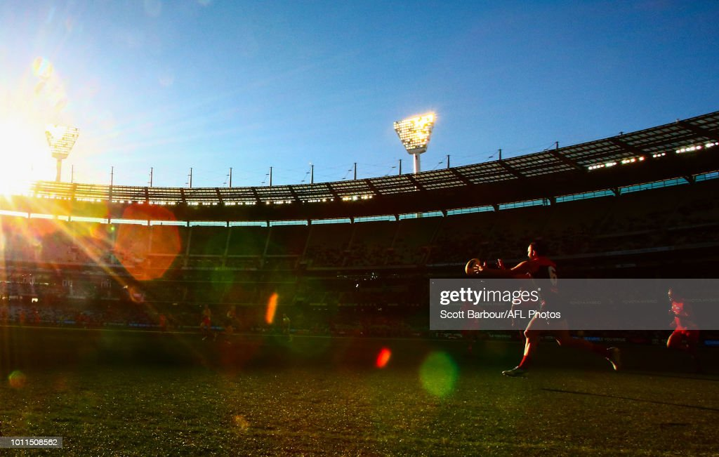 A general view of play as the sun shines and Jordan Lewis of the Demons runs with the ball during the round 20 AFL match between the Melbourne Demons and the Gold Coast Suns at Melbourne Cricket Ground on August 5, 2018 in Melbourne, Australia.