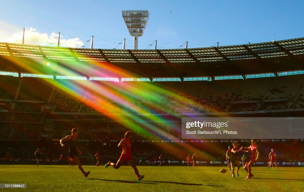 A general view of play as the sun shines and Lachie Weller of the Suns and Bayley Fritsch of the Demons compete for the ball during the round 20 AFL match between the Melbourne Demons and the Gold Coast Suns at Melbourne Cricket Ground on August 5, 2018 in Melbourne, Australia.
