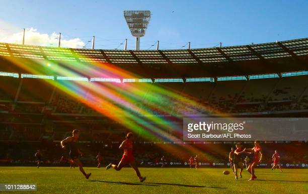 A general view of play as the sun shines and Lachie Weller of the Suns and Bayley Fritsch of the Demons compete for the ball during the round 20 AFL...