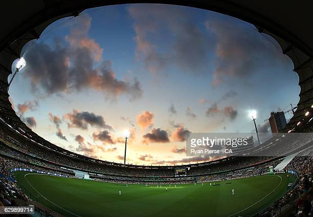 A general view of play at sunset during day one of the First Test match between Australia and Pakistan at The Gabba on December 15 2016 in Brisbane...