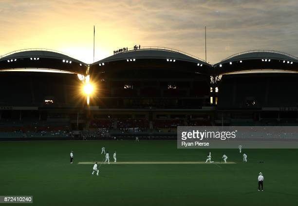 A general view of play at sunset during day three of the four day tour match between Cricket Australia XI and England at Adelaide Oval on November 10...