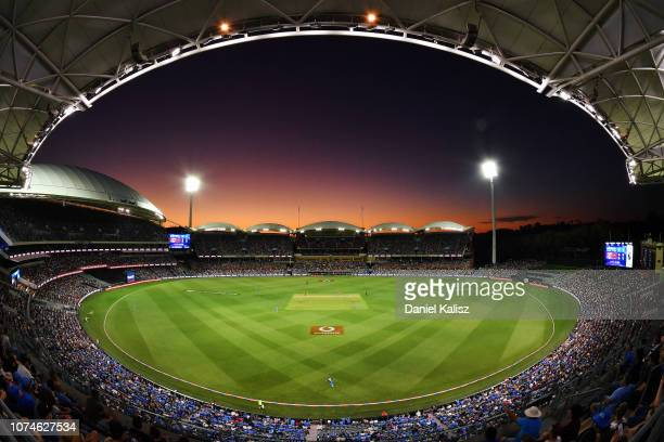 General view of play at sunset during the Adelaide Strikers v Melbourne Renegades Big Bash League Match at Adelaide Oval on December 23, 2018 in...