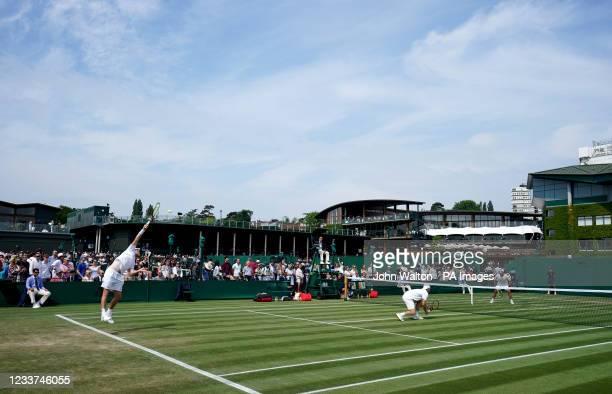 General view of play between Alex de Minaur and Matt Reid during their first round gentlemen's doubles match against Luke Johnson and Anton...
