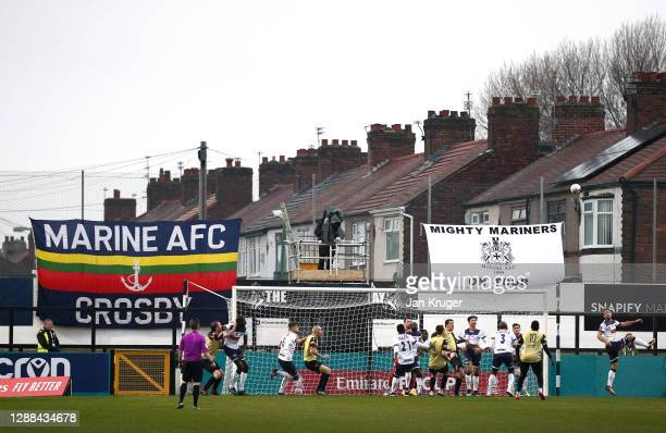 General view of play during the Emirates FA Cup Second Round match between Marine FC and Havant and Waterloovile at The Marine Travel Arena on...