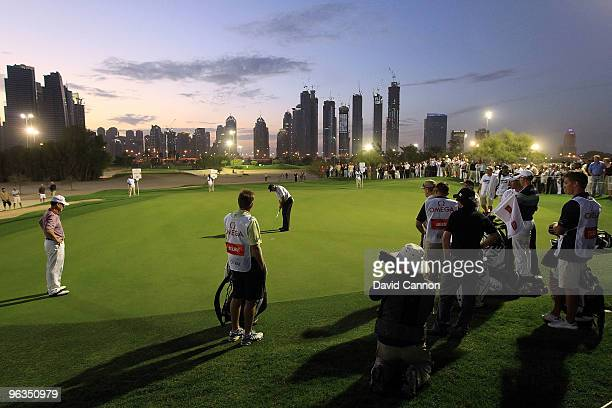 General view of play during the par 3 challenge match under floodlights as a preview for the 2010 Omega Dubai Desert Classic on the Majilis Course at...