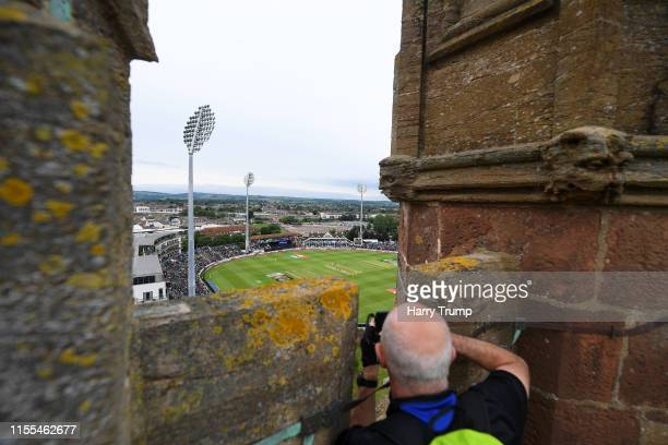 A general view of play from St James Church overlooking the ground as a man takes a picture during the Group Stage match of the ICC Cricket World Cup...