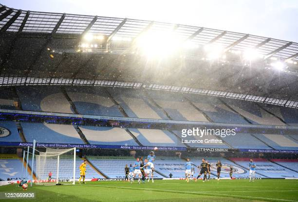 General view of play in front of empty stands during the Premier League match between Manchester City and Arsenal FC at Etihad Stadium on June 17,...