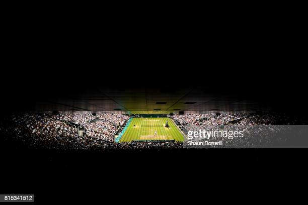 A general view of play of Roger Federer of Switzerland and Marin Cilic of Croatia during Gentlemen's Singles final on day thirteen of the Wimbledon...