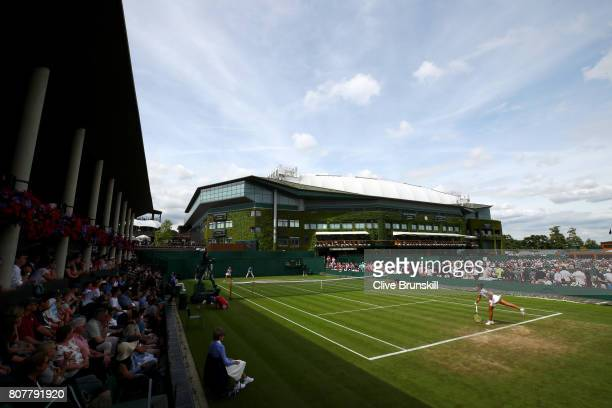 A general view of play on court four during the Ladies Singles first round match between Xinyun Han of China and Zarina Diyas of Kazakhstan on day...