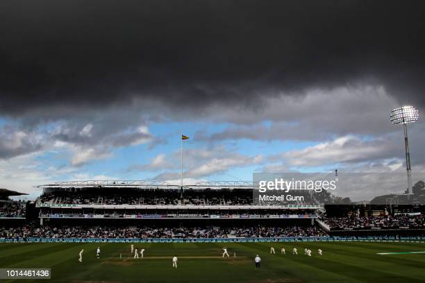 A general view of play with blue sky and dark clouds behind the grandstand during the day two of the Specsavers 2nd Test match between England and...