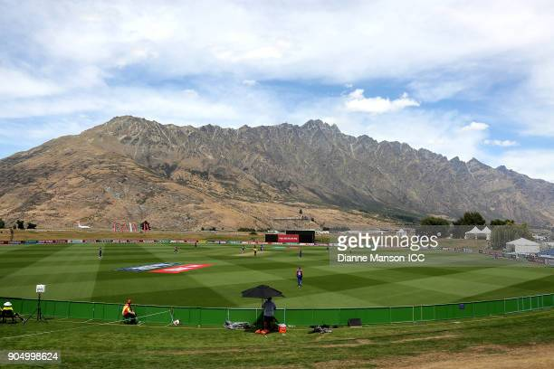 A general view of play with the Remarkables in the background during the ICC U19 Cricket World Cup match between England and Namibia at John Davies...
