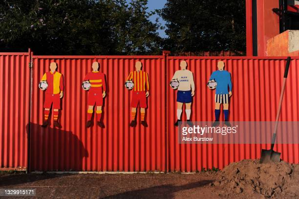 General view of player shaped cut-outs seen on a fence inside the stadium prior to the Pre-Season Friendly match between Banbury United and Oxford...