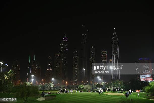 A general view of players on the 8th green during the Challenge Match on the par 3 floodlit course as a preview for the 2013 Omega Dubai Ladies...