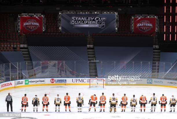 General view of players standing on the ice before the exhibition game between the Pittsburgh Penguins and the Philadelphia Flyers prior to the 2020...