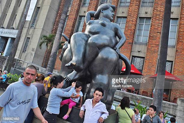 A general view of Plaza Botero where people enjoy 23 monumental sculptures made by Colombia's legendary artist Fernando Botero are on display at the...