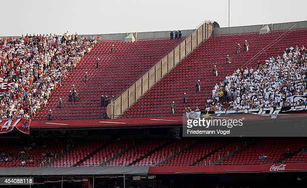 A general view of police betwen Sao Paulo and Santos fans during the match between Sao Paulo and Santos for the Brazilian Series A 2014 at Estadio do...