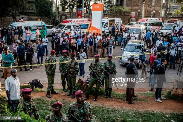 General view of police officers emergency workers and media at the scene of an explosion at a hotel complex in Nairobi's Westlands suburb on January...