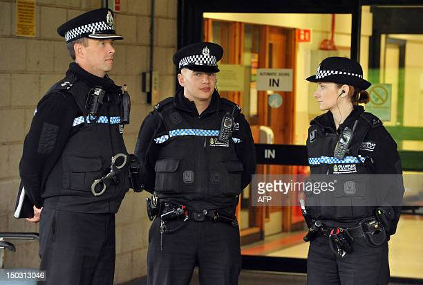 General view of police outside Aberdeen Royal Infirmary where Britain's Prince Philip has been hospitalised on August 15 2012 Britain's Prince Philip...