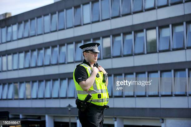 General view of police outside Aberdeen Royal Infirmary where Britain's Prince Philip has been hospitalised on August 16 2012 Britain's Prince Philip...